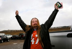 Jesse Phillips celebrates being the first person to legally buy recreational marijuana at the BotanaCare store in Northglenn